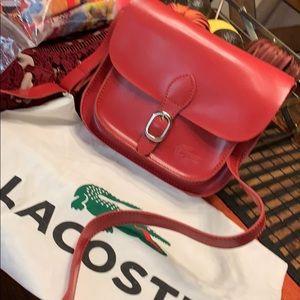 2acb36d679a0 Women s Lacoste Messenger Bag on Poshmark
